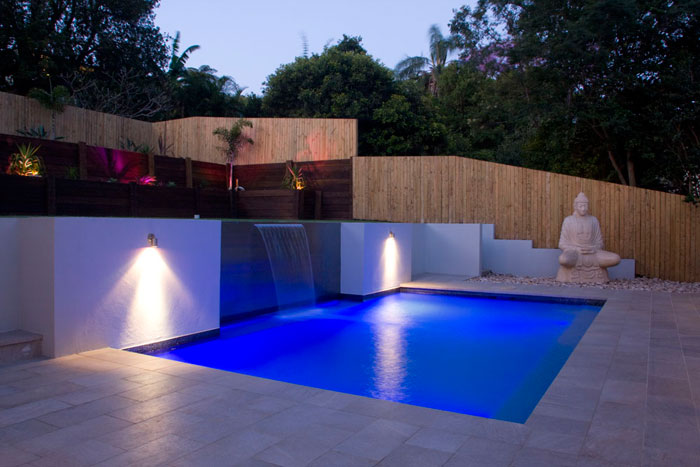 Resort style pool by Malibu Pools. This is a Bali Villa style inspired pool.