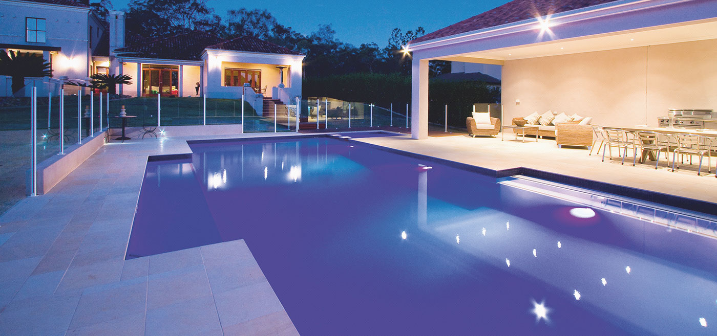 Modern pool against entertainment patio
