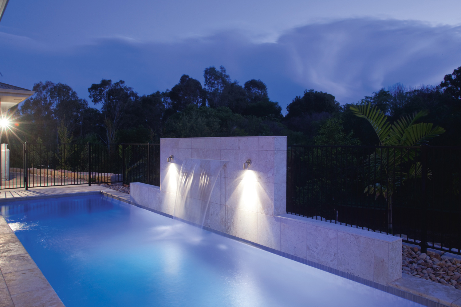 Pool with Water Feature and Custom made lights at night time