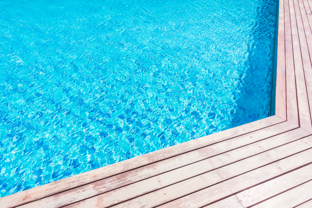 Swimming pool with decking - Malibu Pools